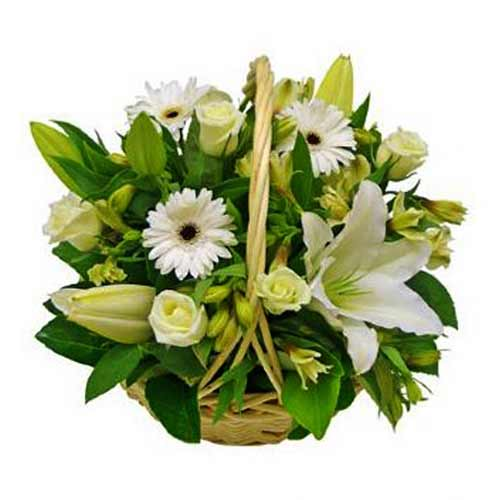 Touching Basket of Fresh Seasonal Flowers in White